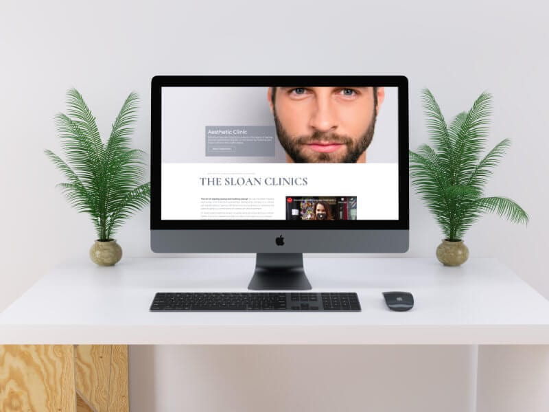 The Sloan Clinics website displayed on an imac